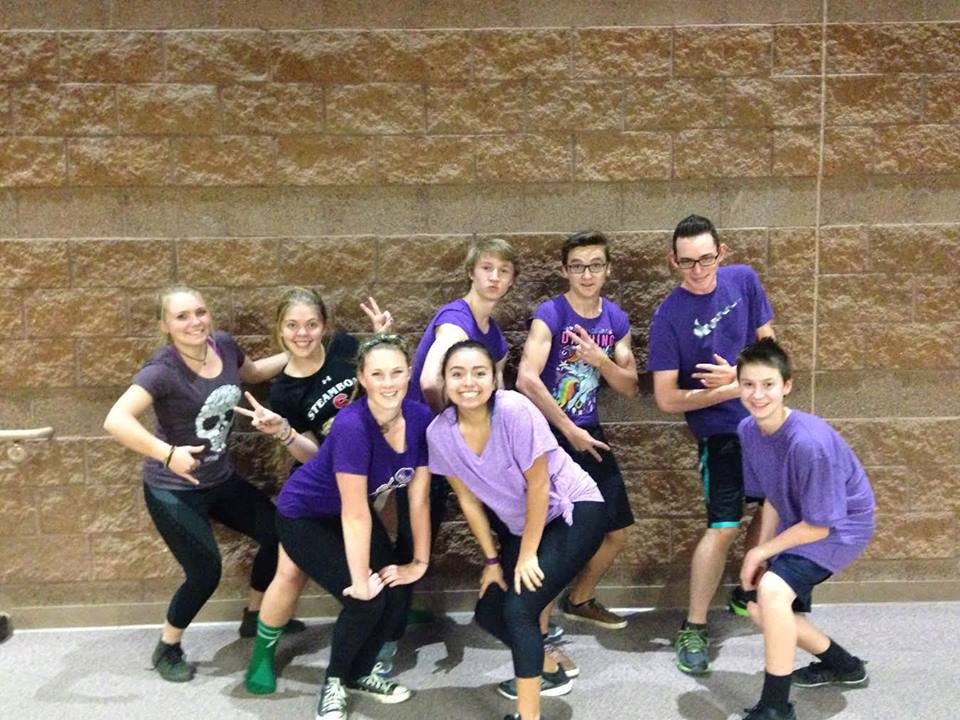 Dodgeball team in purple smiling for camera