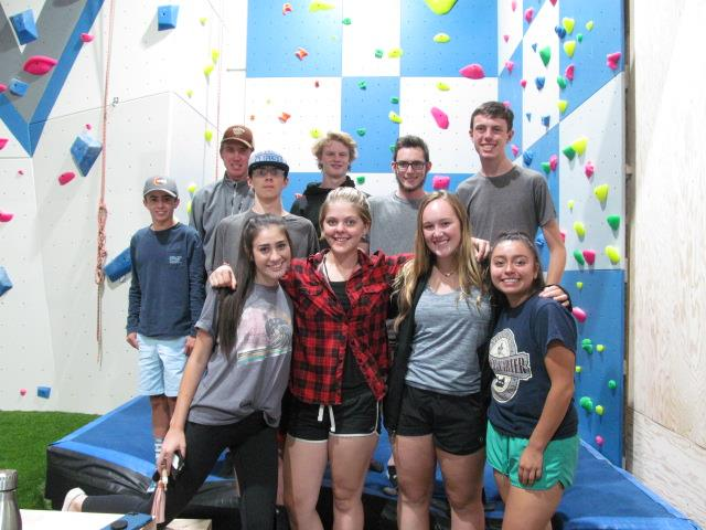 Group of teenagers in front of climbing all smiling for camera